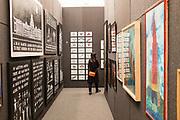 New York, NY - May 3, 2019. Spectators in the narrow corridors of The Doors of Perception, curated ny Javier Téllez, at the Frieze Art Fair on New York City's Randalls Island.