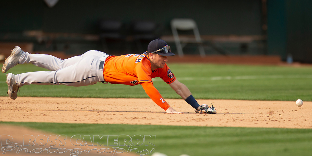 Sep 25, 2021; Oakland, California, USA; Houston Astros third baseman Alex Bregman (2) dives in vain for a single off the bat of Oakland Athletics shortstop Elvis Andrus during the ninth inning at RingCentral Coliseum. Mandatory Credit: D. Ross Cameron-USA TODAY Sports