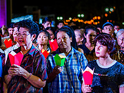 "23 DECEMBER 2018 - CHANTABURI, THAILAND: Women pray at the Cathedral of the Immaculate Conception's Christmas Fair in Chantaburi. Cathedral of the Immaculate Conception is holding its annual Christmas festival, this year called ""Sweet Christmas @ Chantaburi 2018"". The Cathedral is the largest Catholic church in Thailand and was founded more than 300 years ago by Vietnamese Catholics who settled in Thailand, then Siam.   PHOTO BY JACK KURTZ"