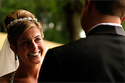 A bride at her wedding ceremony held at Canandaigua Lake, New York.