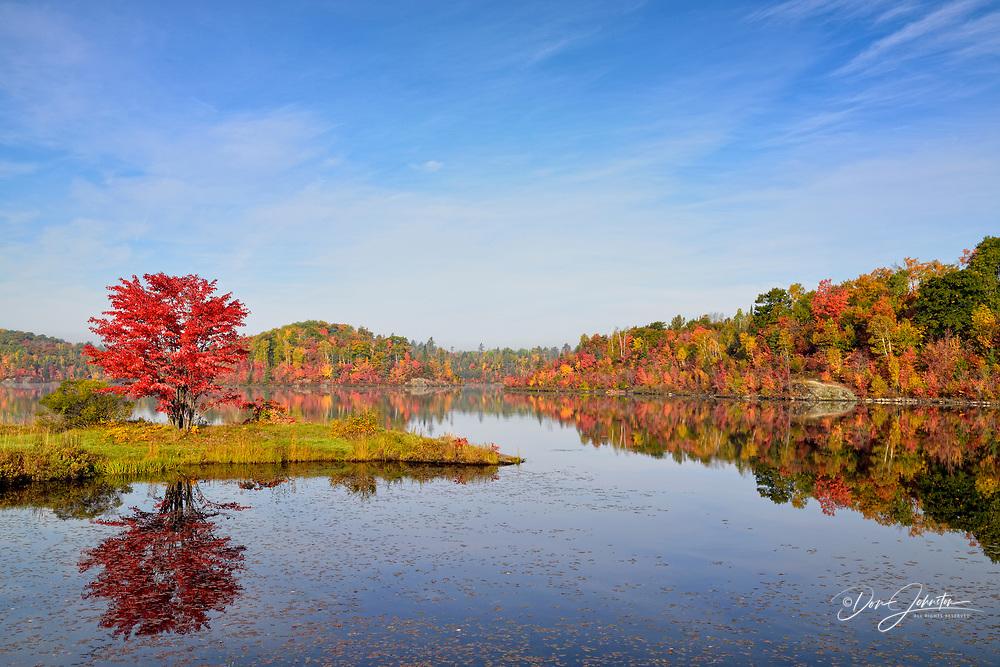 Autumn reflections in St. Pothier Lake, Greater Sudbury (Whitefish), Ontario, Canada