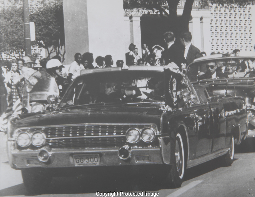 Presidential Limousine in front of the Texas School Book Depository Building at the time of the assassination<br /> <br /> <br /> Photograph: Warren Commission/ Dennis Brack Archives