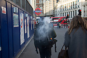 Vaping while walking down the street in London, England, United Kingdom. Vaping is often seen as a safe or safer alternative to smoking. It is also relatively new to the market, only hitting the mainstream over the past decade or so.