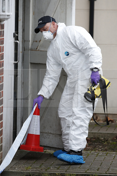 © Licensed to London News Pictures. 05/01/2019. Farnham, UK. Police search a property after a couple were arrested in connection with the murder of a man on a train yesterday. A murder investigation has been launched after the man was attacked while on board the 12. 58pm train service travelling between Guildford and London Waterloo. A man and a woman have been detained by police in Farnham in connection with the murder. Photo credit: Peter Macdiarmid/LNP