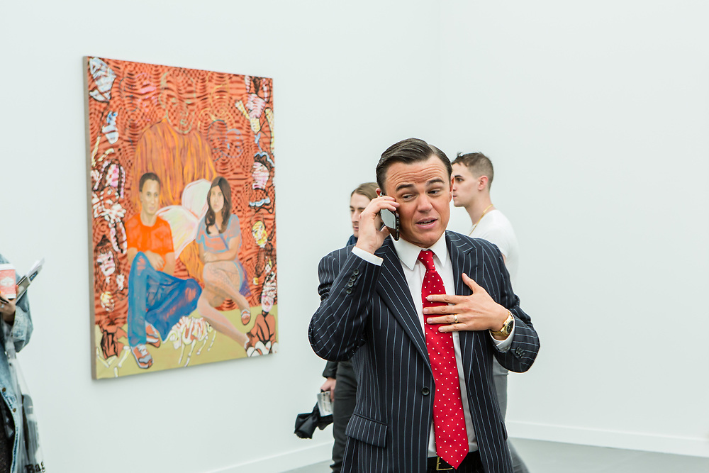 New York, NY - 5 May 2017. The opening day of the Frieze Art Fair, showcasing modern and contemporary art presented by galleries from around the world, on Randall's Island in New York City. A gallerist on the phone discussing the purchase of a work of art with a potential client.