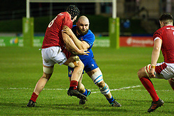 Filippo Alongi of Italy is tackled by Morgan Strong of Wales <br /> <br /> Photographer Craig Thomas/Replay Images<br /> <br /> U20 Six Nations - Wales v Italy  - Friday 31st January 2020 - Stadiwm Zip World (Parc Eirias) - Colwyn Bay<br /> <br /> World Copyright © Replay Images . All rights reserved. info@replayimages.co.uk - http://replayimages.co.uk