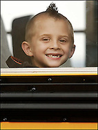 Nicholas Jaycox looks out of the school bus window at Otisville Elementary School, where he was starting his first day of kindergarten, on Sept. 3, 2008. The day was also the first day for students in the new school.