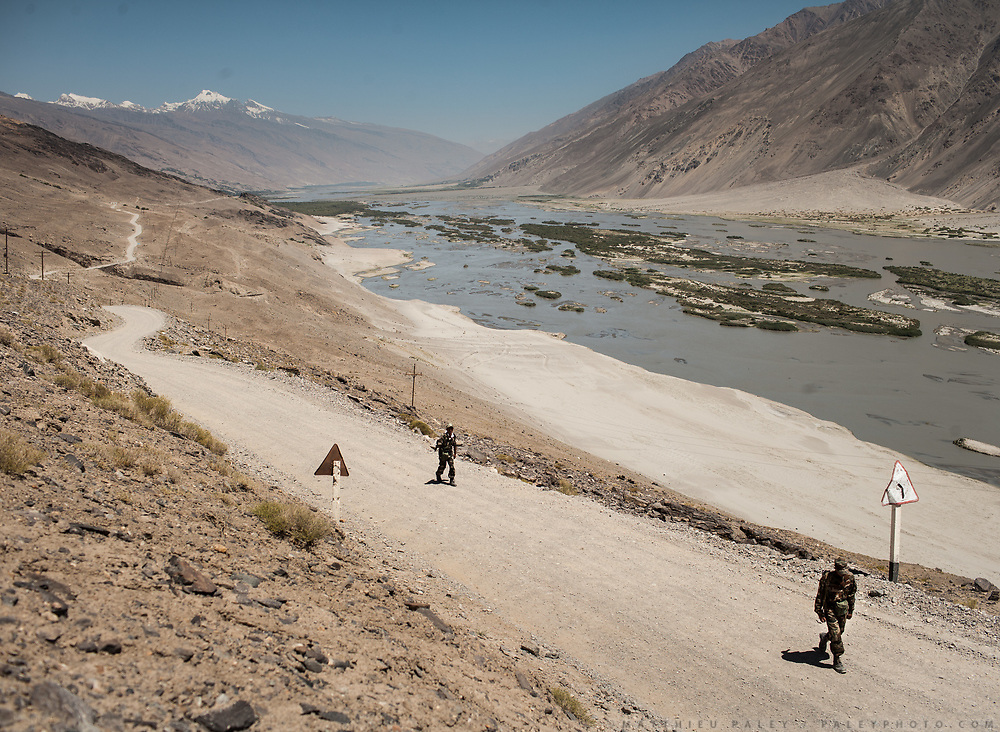 The Tajik army patrolling the Afghan- Tajik border near the Bibi Fatima village in the Wakhan Corridor, Tajikistan side, in the Pamir mountains. Afghanistan is on the other side of the Panj river.<br /> <br /> Tajikistan, a mountainous landlocked country in Central Asia. Afghanistan borders it to the south, Uzbekistan to the west, Kyrgyzstan to the north, and People's Republic of China to the east. Tajikistan also lies adjacent to Pakistan separated by the narrow Wakhan Corridor.<br /> Tajikistan became a republic of the Soviet Union in the 20th century, known as the Tajik Soviet Socialist Republic.<br /> It was the first of the Central Asian republic to gain independence in December 1991.