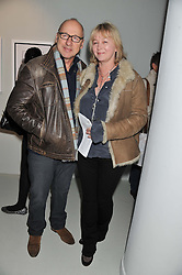 MARK KNOPFLER and his wife KITTY ALDRIDGE at a private view of Bill Wyman - Reworked held at the Rook & Raven Gallery, 7 Rathbone Place, London W1 on 26th February 2013.