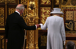 Queen Elizabeth II arrives with the Prince of Wales to deliver a speech from the throne in House of Lords at the Palace of Westminster in London as she outlines the government's legislative programme for the coming session during the State Opening of Parliament. Picture date: Tuesday May 11, 2021.