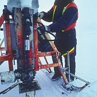 A polar geologist, working in sub-zero temperatures, drills dynamite holes in search of minerals on far north of the Arctic Circle on Spitsbergen Island.