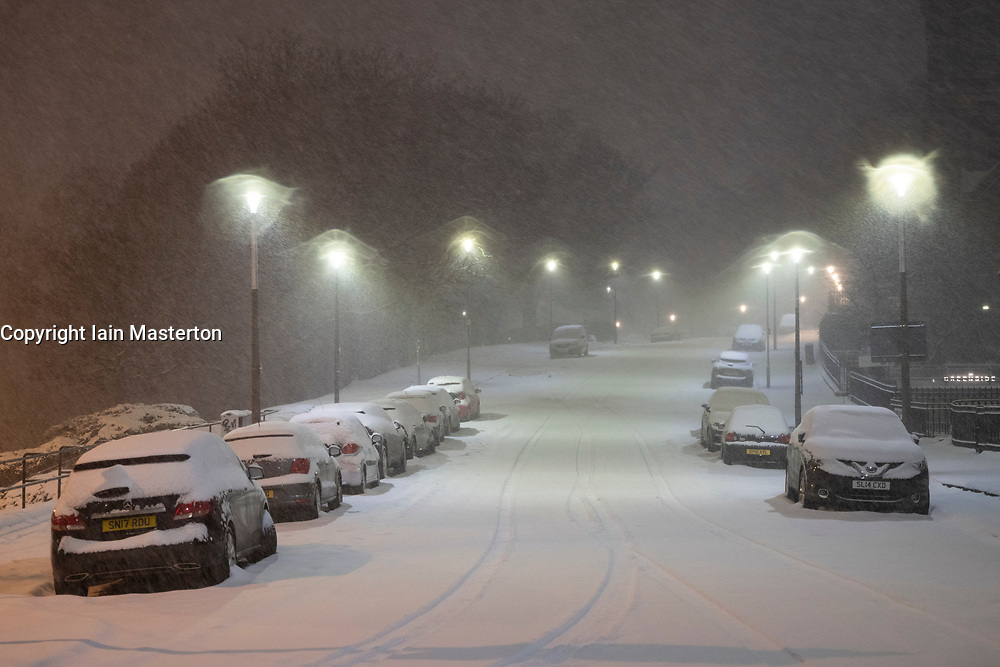 Edinburgh, Scotland, UK. 10 Feb 2021. Big freeze continues in the UK with heavy overnight and morning snow bringing traffic to a standstill on many roads in the city centre. Pic; Blenheim Place at 6qm was covered in thick snow.  Iain Masterton/Alamy Live news