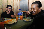Ecuador, May 15 2010: Paul and Lorna enjoy their meal of typical  Cofan food at the Cofan Lodge. Copyright 2010 Peter Horrell