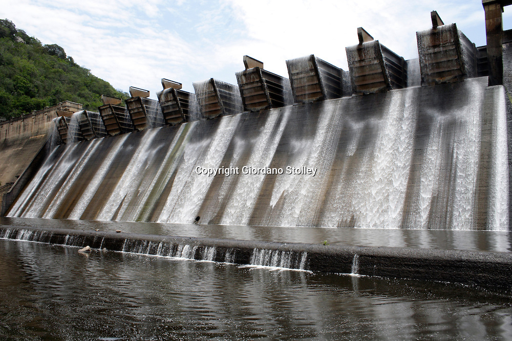 """DURBAN - 31 December 2005 - The Shongweni Dam Wall on the outskirts of Durban. with the largest """"Hydroplus Fuse Gate"""" system in the world. For the historian, the original water works are preserved as a national monument and surrounding the dam is a game park which stocks Rhino, Buffalo, Giraffe, Zebra, Impala, Waterbuck, Kudu, Wildebeest, Caracal, Black backed Jackal, Dassie, Warthog, Ostrich, 3 Duiker species, Mongoose and the smaller mammals as well as 200 species of bird.Picture: Giordano Stolley"""