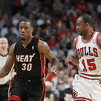 14 March 2012: Miami Heat point guard Norris Cole (30) brings the ball up court past Chicago Bulls point guard John Lucas (15) during the Chicago Bulls 106-102 victory over the Miami Heat at the United Center, Chicago, Illinois, USA.