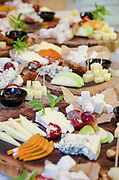 Finger food, snacks and various cheese sandwiches laid out on a table