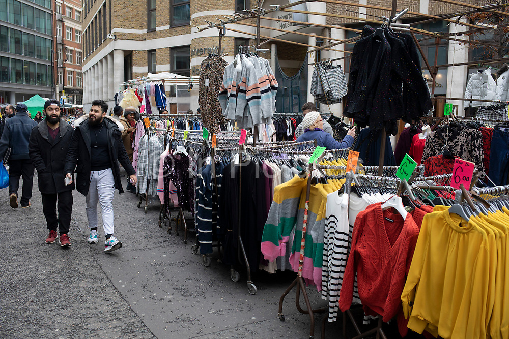 People out shopping on Pettycoat Lane Market in the City of London on 2nd February 2020 in London, England, United Kingdom. Petticoat Lane Market is a fashion and clothing market in the East End of London. It consists of two adjacent street markets. Wentworth Street Market is open six days a week, and Middlesex Street Market is open on Sunday only. The name Petticoat Lane came from not only the sale of petticoats but from the fable that they would steal your petticoat at one end of the market and sell it back to you at the other.