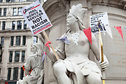 "Statues used as protesters holding placards. Occupy London protest at St Pauls, October 16th 2011. Protest spreads from the US with this demonstrations in London and other cities worldwide. The 'Occupy' movement is spreading via social media. After four weeks of focus on the Wall Street protest, the campaign against the global banking industry started in the UK this weekend, with the biggest event aiming to ""occupy"" the London Stock Exchange. The protests have been organised on social media pages that between them have picked up more than 15,000 followers. Campaigners gathered outside  at midday before marching the short distance to Paternoster Square, home of the Stock Exchange and other banks.It is one of a series of events planned around the UK as part of a global day of action, with 800-plus protests promised so far worldwide.Paternoster Square is a private development, giving police more powers to not allow protesters or activists inside."
