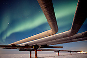 Alaska. Aurora Borealis over the Alyeska Pipeline on the North Slope Borough.