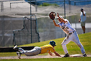 Coeur d'Alene Lumbermen first baseman Matt Cade recieves a pick-off throw as a Lewis-Clark Twin slides safely back into the bag during Sunday's AA District Trounament at Post Falls High School.