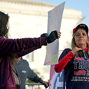 Protesters for and against President Donald Trump's Supreme Court nominee Judge Amy Coney Barrett demonstrate outside the Supreme Court on Monday, October 26, 2020 prior to her full vote in the Senate.