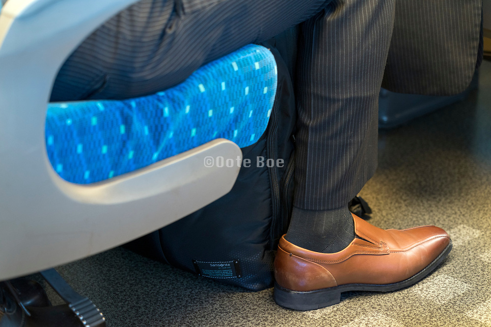 business person while traveling in the Shinkansen bullet train Japan