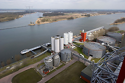 An overview of the bio-mass storage facility at the Essent Energie power station, in Geertruidenberg, Netherlands, on Monday March 22, 2010. Bio-mass or compressed wood, is added to the coal for a cleaner burn, in an effort to make the production of electricity more environmentally friendly. Essent Energie is owned by RWE AG. (Photo © Jock Fistick)
