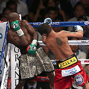 LAS VEGAS, NV - SEPTEMBER 13: Floyd Mayweather Jr. (L) tries to avoid a punch by Marcos Maidana during their WBC/WBA welterweight title fight at the MGM Grand Garden Arena on September 13, 2014 in Las Vegas, Nevada. (Photo by Alex Menendez/Getty Images) *** Local Caption *** Floyd Mayweather Jr; Marcos Maidana