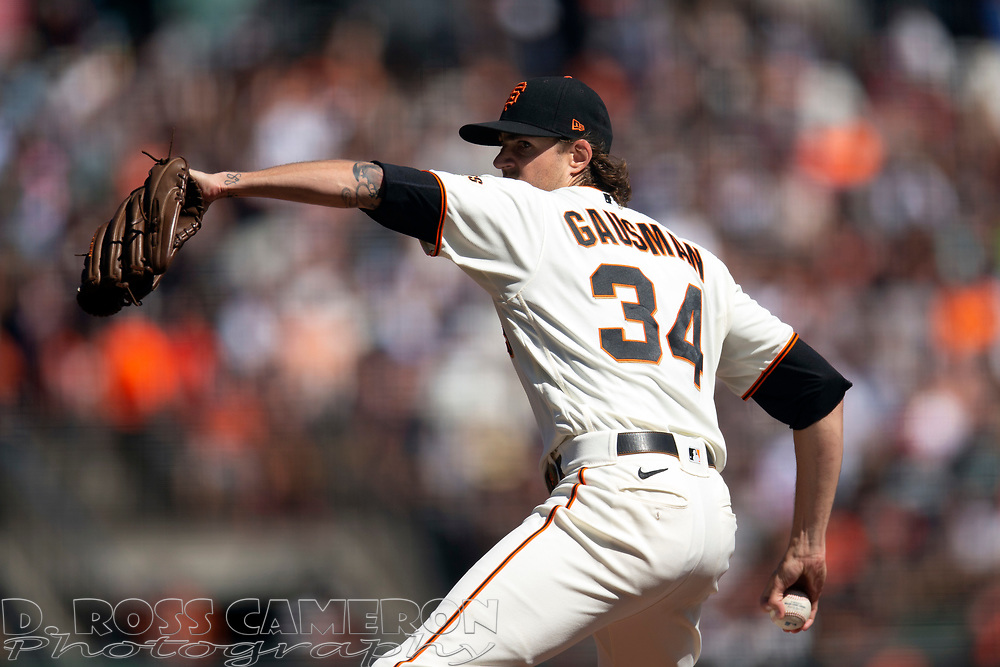 San Francisco Giants starting pitcher Kevin Gausman (34) delivers a pitch against the San Diego Padres during the second inning of a baseball game, Saturday, Oct. 2, 2021, in San Francisco. (AP Photo/D. Ross Cameron)