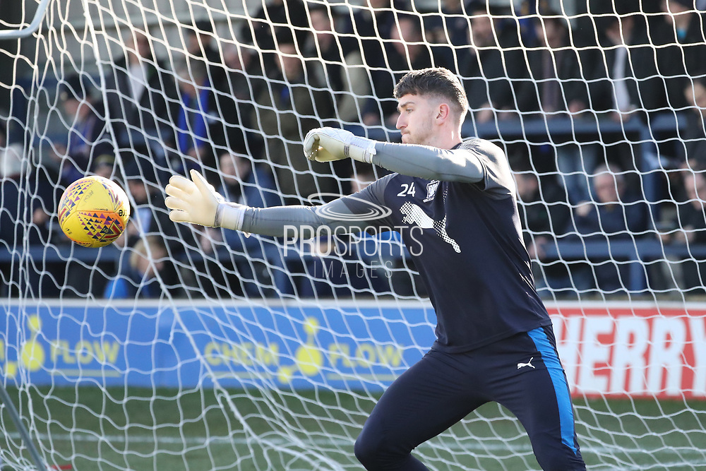 AFC Wimbledon goalkeeper Joe McDonnell (24) warming up during the EFL Sky Bet League 1 match between AFC Wimbledon and Bristol Rovers at the Cherry Red Records Stadium, Kingston, England on 17 February 2018. Picture by Matthew Redman.