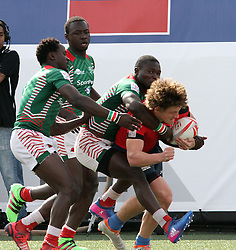March 5, 2017 - Las Vegas, Nevada, United States of America - Kenyan players gang tackle Russian Vladislav Sozonov during the 2017 USA Sevens International Rugby Tournament game between Kenya and Russia on March 4, 2017  at Sam Boyd  Stadium  in Las Vegas, Nevada (Credit Image: © Marcel Thomas via ZUMA Wire)