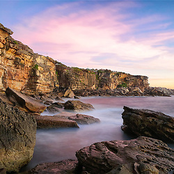 Coogee Beach Cliff face looking North. It was a beautiful sunrise. There wasnt much cloud on the Horizon but this nice whispy cloud picked up some colour. This is a 2 minute exposure