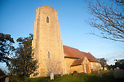 Historic round tower set against deep blue sky, All Saints church, Ramsholt, Suffolk, England