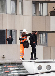 Tom Cruise (right) on Blackfriars Bridge in London, during filming for Mission Impossible 6.