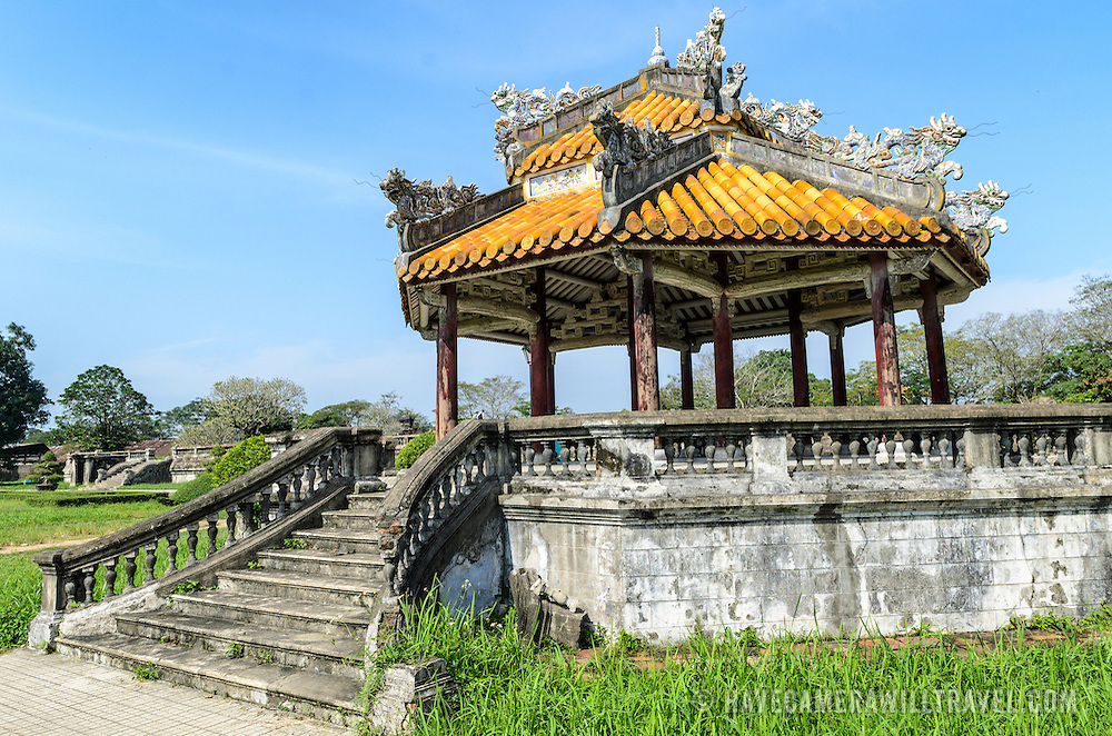 A restored pagoda at the Imperial City in Hue, Vietnam. A self-enclosed and fortified palace, the complex includes the Purple Forbidden City, which was the inner sanctum of the imperial household, as well as temples, courtyards, gardens, and other buildings. Much of the Imperial City was damaged or destroyed during the Vietnam War. It is now designated as a UNESCO World Heritage site.