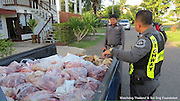 dog butchers arrested on Highway after carrying more than 100 slaughtered Dogs in Thailand<br /> <br /> Two more dog butchers are out of business. , Soi Dog undercover investigators and the Thai police were alerted to a truck en route to Tha Rae, north-eastern Thailand - the heart of dog meat territory.<br /> Cornered by the police car, the truck had no choice but to stop. Concealed in the back of the pick-up were the carcasses of more than one hundred dogs.<br /> <br /> Traditionally, these snatched dogs would have been transported alive – often up to 10 dogs to a cage and for days at a time – to primitive butcher premises, where they would be tortured and slaughtered.<br /> Under questioning, the occupants of the truck confessed that due to the ever increasing number of arrests, they had slaughtered the dogs before transport, in the hope that they would be easier to conceal and the truck would not be stopped.<br /> The public awareness billboards are leading to more and more arrests and forcing the dog snatchers into a corner! <br /> The butchers were promptly arrested and will now face charges under both the Prevention of Contagious Diseases Act and Thailand's first ever Animal Welfare Law, brought into effect <br /> ©Soi Dog Foundation/Exclusivepix Media