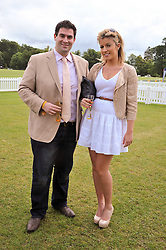ZAFAR RUSHDIE and NATHALIE COYLE at the 2011 Veuve Clicquot Gold Cup Final at Cowdray Park, Midhurst, West Sussex on 17th July 2011.