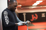 UFC middleweight Derek Brunson of North Carolina wraps his hands before training at Jackson Wink MMA in Albuquerque, New Mexico on June 9, 2016.