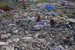 September 30, 2018 - Dhaka, Bangladesh - Women workers separate plastic bags on a wasteland in the outcast of Dhaka. A recent report by World Bank say, the country loses about $6.5 billion due to pollution and environmental degradation in urban arears in every year. (Credit Image: © MD Mehedi Hasan/ZUMA Wire)
