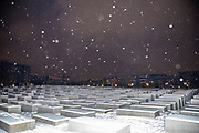 A view of the Holocaust Memorial during snowfall at the central Mitte district in Berlin, Germany, February 09, 2021. Germany is experiencing several days of sub-zero temperatures strong winds and snow.