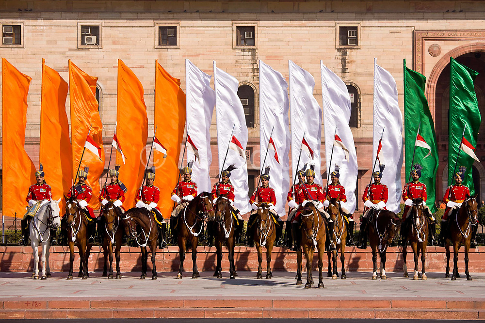 Soldiers  of the Presidential Bodyguard begin the  Changing of the Guard ceremony as they march past the Central Secretariat towards the Rashtrapati Bhavan Palace. They march in formation for the 40 minute Saturday  ceremony where they will take up their posts in guarding the palace. They march from the grounds of the Palace up the Rajpath to the Central Secretariat, or Ministry of Defence and back to the palace grounds where they will hand the ceremonial keys to their replacement soldiers. The PBG is the Indian Army's preeminent regiment founded in 1773 during the British occupation, this handpicked unit began with a mere 50 men and today stands at 160 soldiers plus 50 support staff. It has a dual role, both as a ceremonial guard for the President of India, with all its finery at important state functions, as well as an elite operational unit for the Indian Army which has seen action in many battle fronts, in particular the on going disputed region of Kashmir.