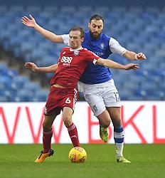 Birmingham City's Maikel Kieftenbeld battles with Sheffield Wednesday's Atdhe Nuhiu