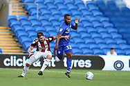 Kieron Freeman of Sheffield United (l) tries to stop Junior Hoilett of Cardiff city (r). EFL Skybet championship match, Cardiff city v Sheffield Utd at the Cardiff City Stadium in Cardiff, South Wales on Tuesday 15th August 2017.<br /> pic by Andrew Orchard, Andrew Orchard sports photography.