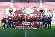 The Hearts players lift the SPFL Championship trophy after the final whistle of the SPFL Championship match between Heart of Midlothian and Inverness CT at Tynecastle Park, Edinburgh Scotland on 24 April 2021.