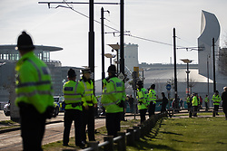 "© Licensed to London News Pictures . 23/02/2019. Salford, UK. Police in Media City . Supporters of Tommy Robinson (real name Stephen Yaxley-Lennon ) and anti-fascists opposed to the former EDL leader and his followers , gather near to the BBC at Media City to protest , as Yaxley-Lennon hosts a rally showing a home-made documentary , "" Panodrama "" , described as an exposé of the BBC's Panorama documentary series . A BBC Panorama documentary is due to feature an investigation in to Yaxley-Lennon in the near future . Photo credit: Joel Goodman/LNP"