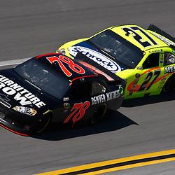 April 17, 2011; Talladega, AL, USA; NASCAR Sprint Cup Series driver Paul Menard (27) drafts Regan Smith (78) during the Aarons 499 at Talladega Superspeedway.   Mandatory Credit: Derick E. Hingle