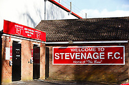 Ground shot of Stevenage FC Signage depicting the locked up turnstiles and sanitiser stations during the EFL Sky Bet League 2 match between Stevenage and Bradford City at the Lamex Stadium, Stevenage, England on 5 April 2021.