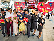 14 FEBRUARY 2016 - BANGKOK, THAILAND: Thai Tourist Police hand out flowers to tourists during a Valentine's Day publicity stunt in the BTS National Stadium skywalk.        PHOTO BY JACK KURTZ