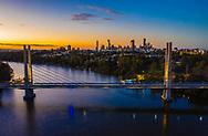 Aerial view of Eleanor Schonell Bridge over the Brisbane River, Brisbane city in the distance, Queensland, Australia