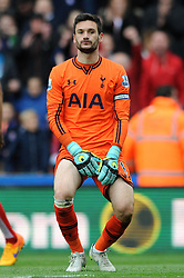 Tottenham Hotspur's Hugo Lloris cuts a dejected figure as Stoke City's Steven N'Zonzi celebrates - Photo mandatory by-line: Dougie Allward/JMP - Mobile: 07966 386802 - 09/05/2015 - SPORT - Football - Stoke - Britannia Stadium<br />  - Stoke v Tottenham Hotspur - Barclays Premier League